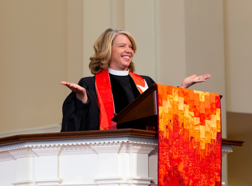Rev. Sarah Butter preaches from the pulpit of the Wellesley Village Church
