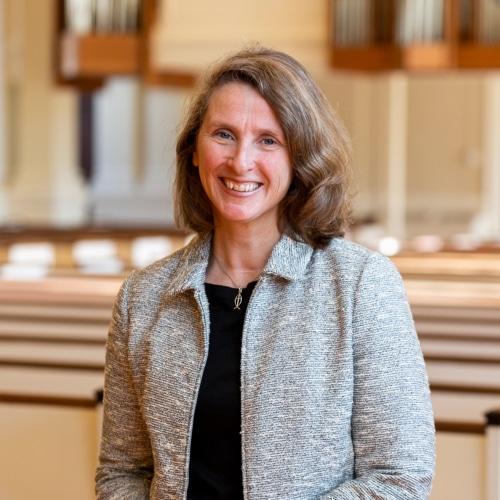 Rev. Diane Seaborn in the pews of Village Church