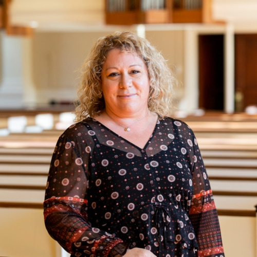 Michaela McDonald in the pews of Village Church