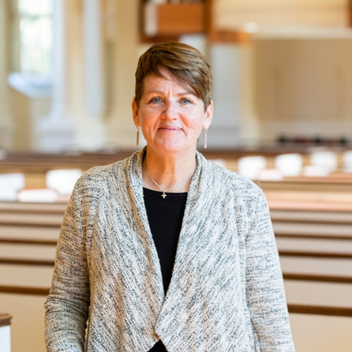 Rev. Pam Emslie in the pews of Village Church