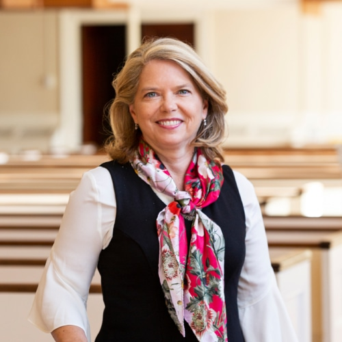 Rev. Dr. Sarah Butter in the pews of Village Church