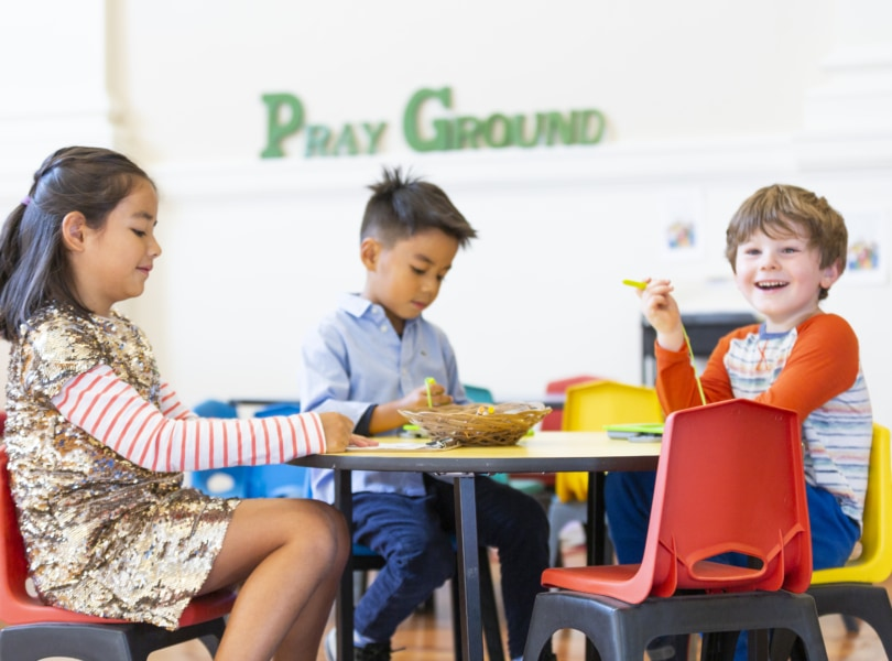 Children at table in church