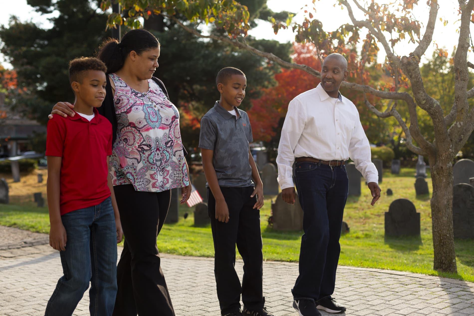 Family walks toward church