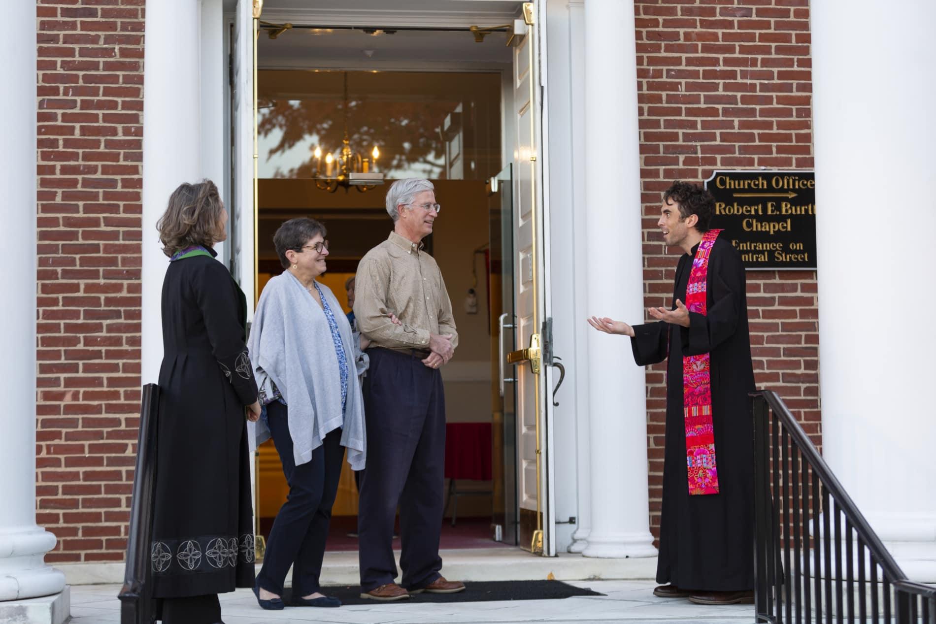 Pastors greet couple