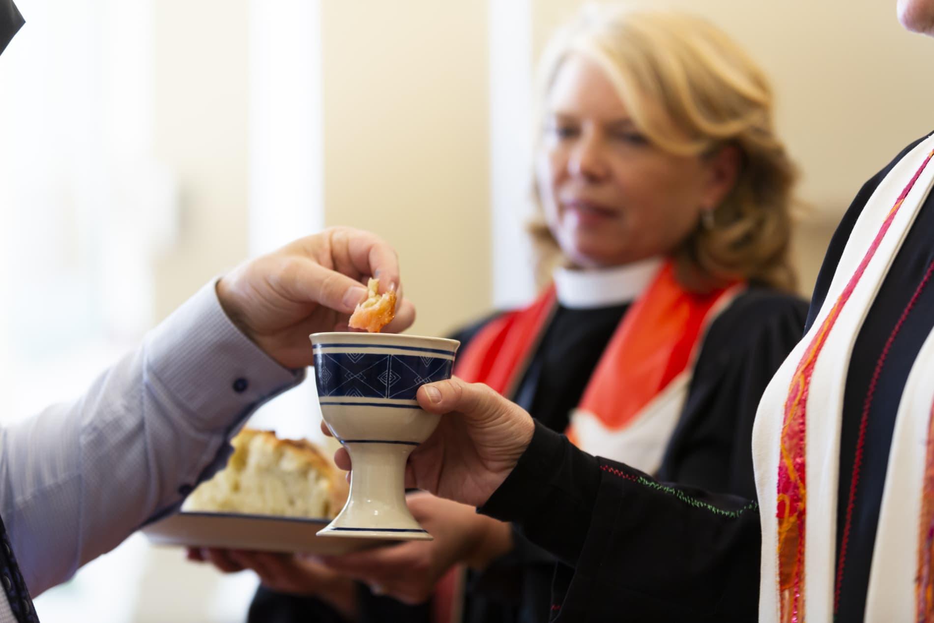Pastor sharing communion