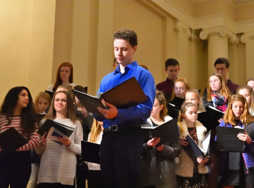 Teen sings with choral group