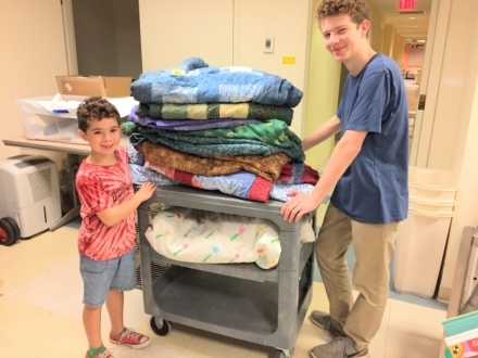 Man and child get bedding ready