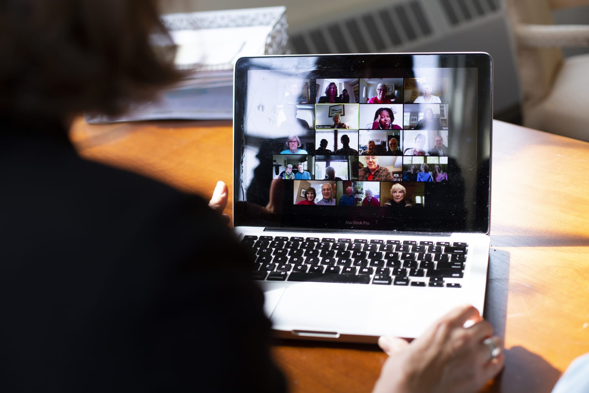 A group of people gather on Zoom for a virtual adult education session