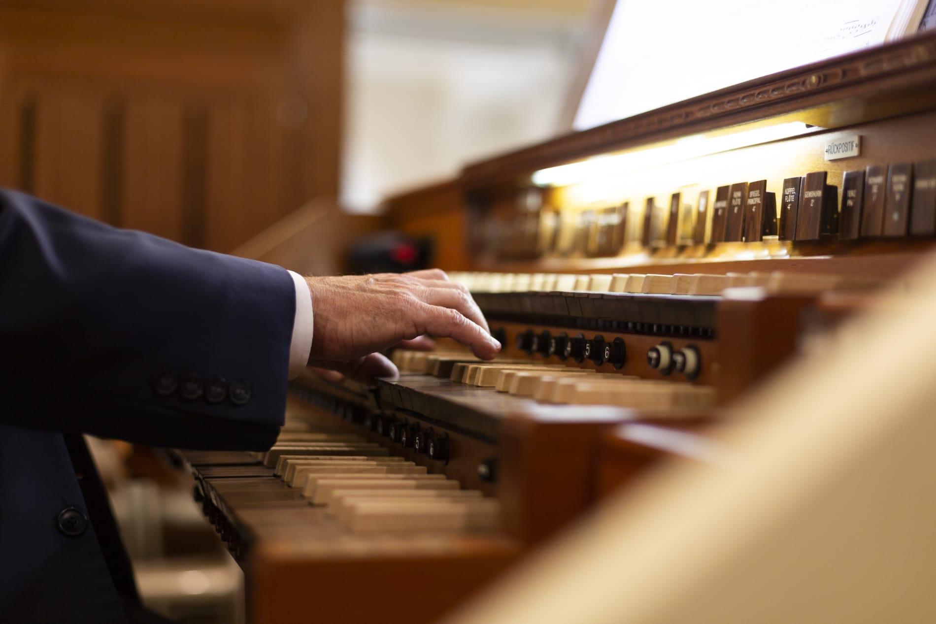 An organist plays the organ