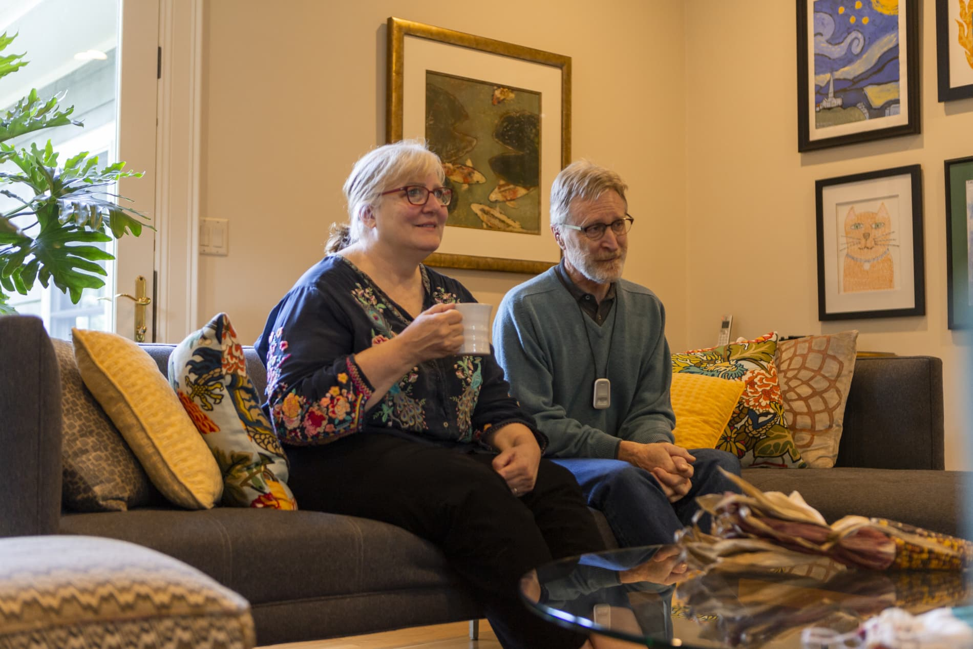 Couple watches worship while sipping coffee at home