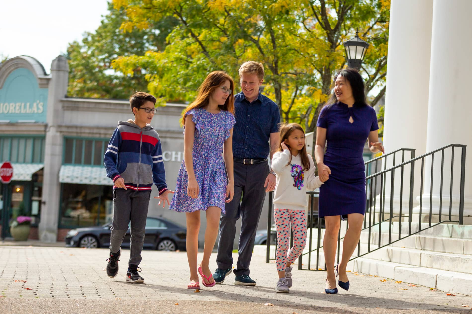 A multi-racial family of five walks up to church