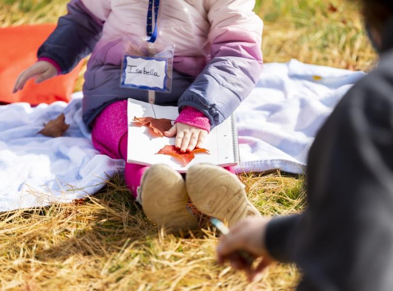 Child makes a craft at Children's Church