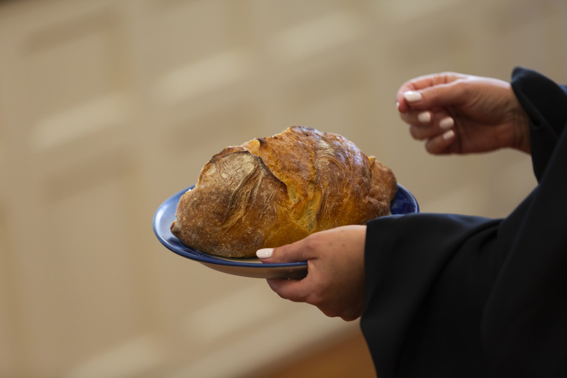 Communion plate holds loaf of bread