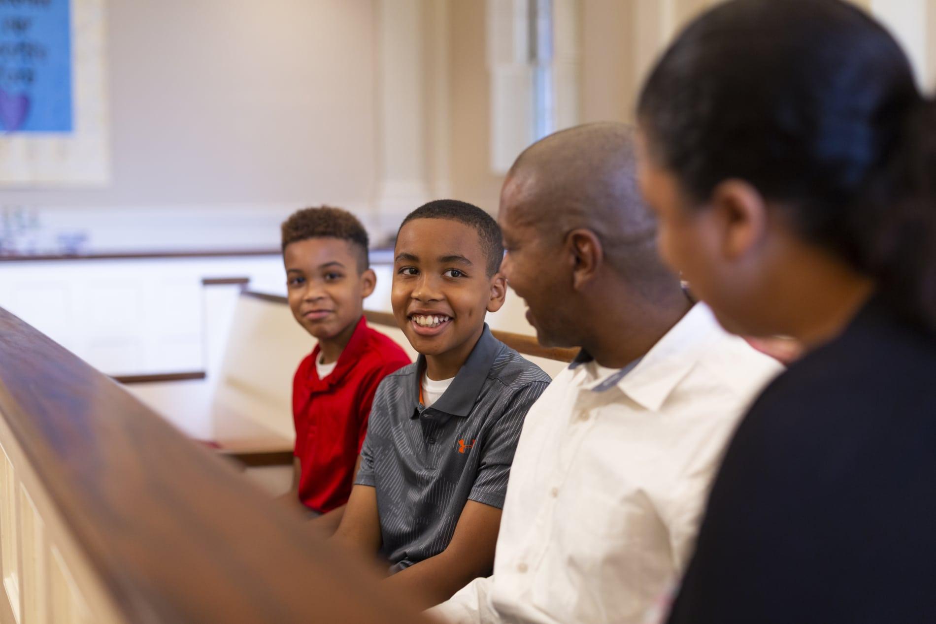 Family in pew in church